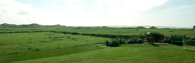 Blick aus dem Schlafzimmer zum Golfplatz und Strand
